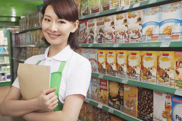 Female Sales Clerk Working in a Supermarket