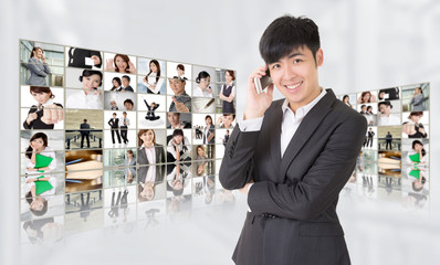 Young businessman talk on phone