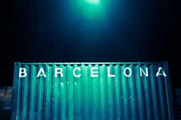 Barcelona lettering on a container at night