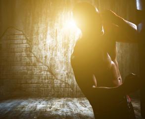 boxer man during boxing hiting heavy bag