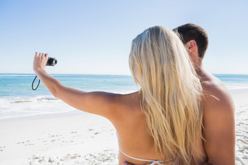 Blonde taking picture of herself with boyfriend