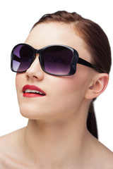 Cheerful sensual model wearing classy sunglasses