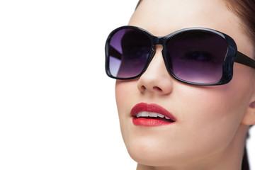 Sensual model wearing classy sunglasses