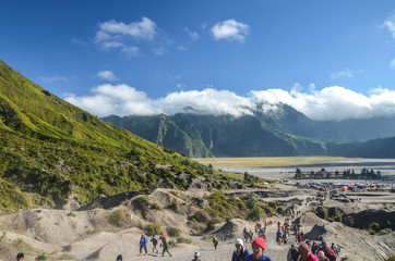 JAVA,INDONESIA-JULY 23 : Tourists hiking up to the crater of the