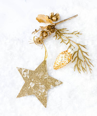 Christmas card with golden star and decorations on snow   lights