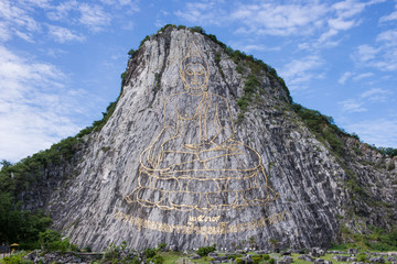Carved buddha image on the cliff at Khao Chee Jan, Pattaya, Thai