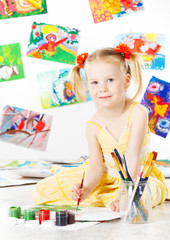 child drawing, girl painting with brush, Creativity concept.