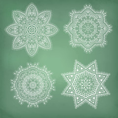 Set of arabesques. Lace ethnic ornament in a circle. Snowflakes.