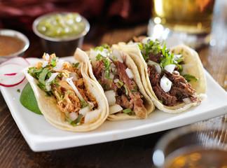 authentic mexican barbacoa, carnitas and chicken tacos