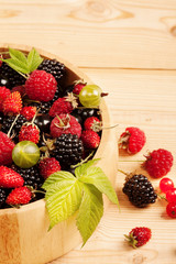 Ripe Berries on Wooden Background