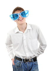 Teenager in Big Blue Glasses