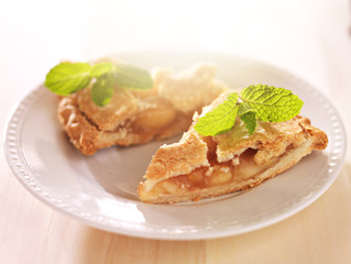 apple pie with mint garnish in warm sunlight