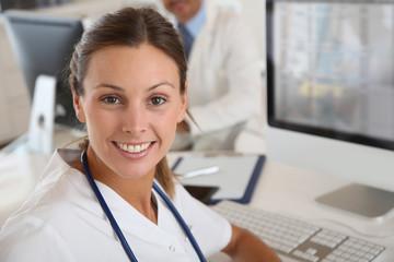 Beautiful nurse working in hospital office