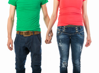 Man and woman in casual clothing holding hands