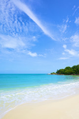 beautiful beach and tropical sea under the bright blue sky