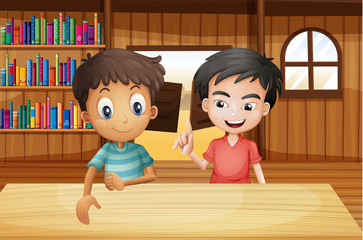 Two boys inside the saloon bar with books