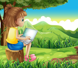 A girl surfing the net at the forest