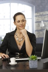 Young woman working at office
