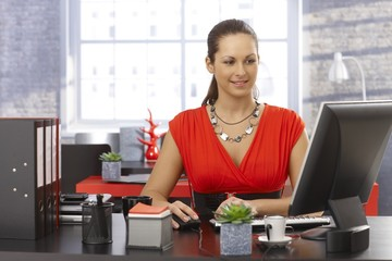 Pretty businesswoman working on computer