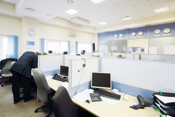 People work in big light office