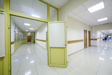 Two light white corridors with doors to offices