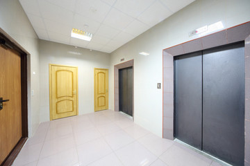Metal doors to elevators and offices in modern office building.