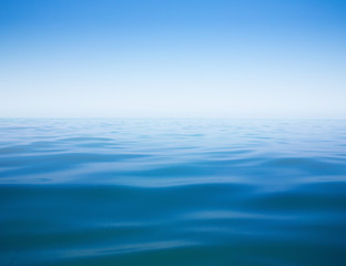 Tuinposter Zee / Oceaan clear sky and calm sea or ocean water surface background