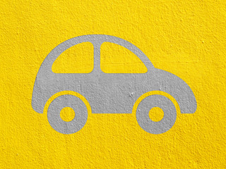 Car on  yellow cement wall
