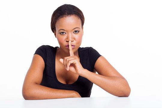 african american woman saying shhh