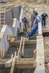 manual workers pouring concrete steps 2