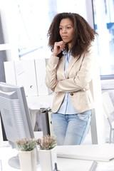 Afro businesswoman thinking at office
