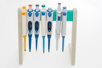 Colorful medical pipettes on white background