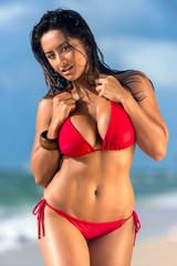 Hot female walking in the beach