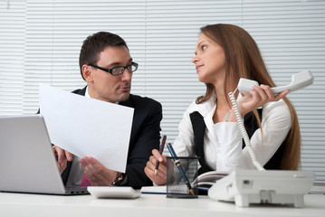 Businesspeople looking at a document in an office