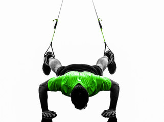 Wall Mural - man exercising suspension training  trx silhouette