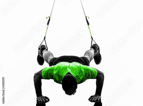 Wall mural man exercising suspension training  trx silhouette