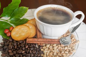 Smoking hot coffee,  beans,Cinnamon and Cracker .