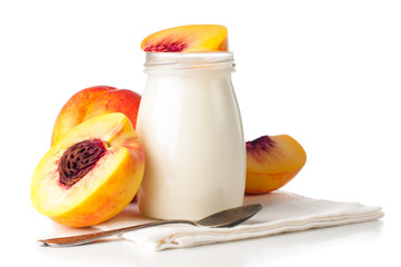 jar of yogurt and sliced nectarines