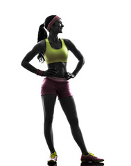 Wall Mural - woman exercising fitness  standing looking away silhouette