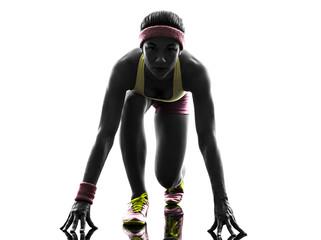Wall Mural - woman runner running on starting blocks silhouette