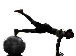 Wall Mural - woman exercising fitness workout plank position silhouette