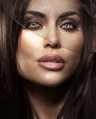 Closeup portrait of brunette beauty.