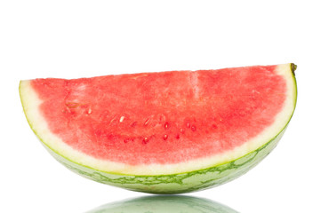 Sliced watermelon over a white reflective background