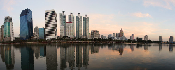 Panorama of Bangkok city downtown at evening with reflection of