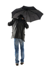 Man with black umbrella walking on a white background