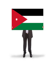 Businessman holding a big card, flag of Jordan