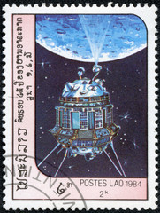 stamp printed in Laos shows communication satilate