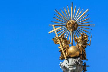 Golden trinity top of a pest column