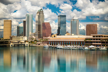 Tampa Florida skyline with sun,  clouds and reflections