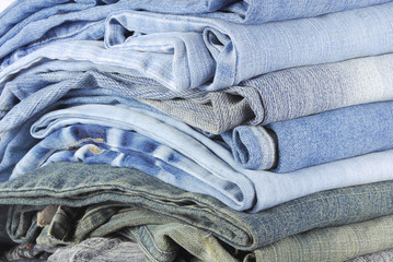 stack of various jeans